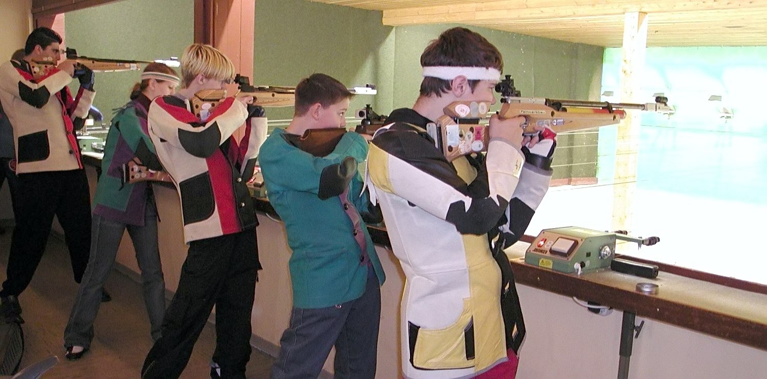 Young Switzerland citizens practicing at a gun range.